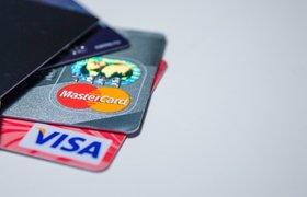 «Коммерсантъ» сообщил о возможном уходе Visa и Mastercard из России