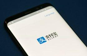 В магазинах с терминалами «Тинькофф банка» появится прием платежей через Alipay