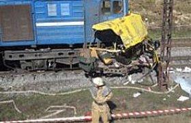 Число жертв столкновения автобуса и поезда достигло 38. ФОТО. ВИДЕО
